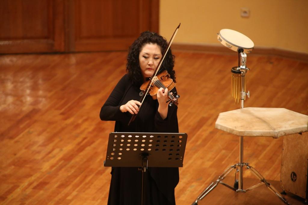 Дина Курманалинова